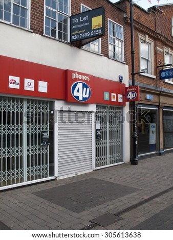 Newbury, Northbrook Street, Berkshire, England - August 07, 2015: Phones 4U vacant premises due to the company going into administration September 2014 - stock photo