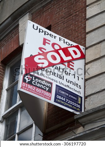 Newbury, Northbrook Street, Berkshire, England - August 07, 2015: Sold upper floor sold sign over retail business premises - stock photo