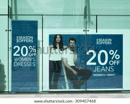 Newbury, Parkway Shopping Centre, Berkshire, England - August 07, 2015: Debenhams department store window display advertising new season offers - stock photo