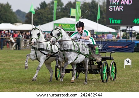NEWBURY, UK - SEPTEMBER 21: An unnamed driver & passenger propel their scurry race rig around the course at speed attempting to set the fastest time at the Berks show on September 21, 2014 in Newbury - stock photo