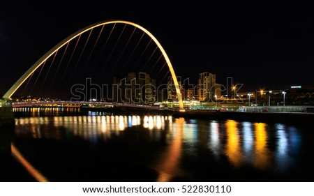 Newcastle and Gateshead at sundown showing Gateshead Millennium Bridge , sage and Tyne Bridges.