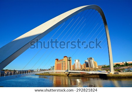 NEWCASTLE, ENGLAND - JUNE 10: Bridge on River Tyne on June 10, 2015 at Newcastle, England. Newcastle is famous of its bridges above Tyne River. - stock photo
