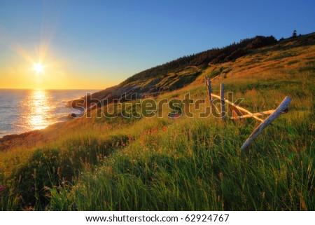 Newfoundland coastline at sunrise. - stock photo
