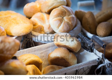 Newly-baked scones and buns at display in modern bakery - stock photo