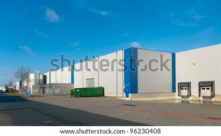 newly build industrial warehouse with office unit - stock photo