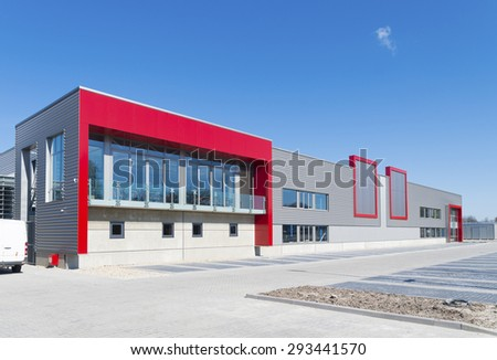 newly build modern red office building with warehouse