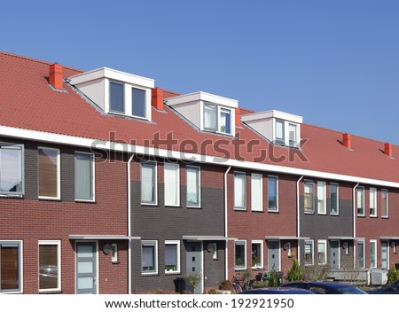 newly build terraced houses with dormer windows