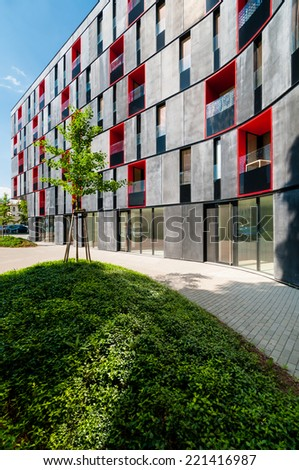Newly built block of flats in modern design with red color