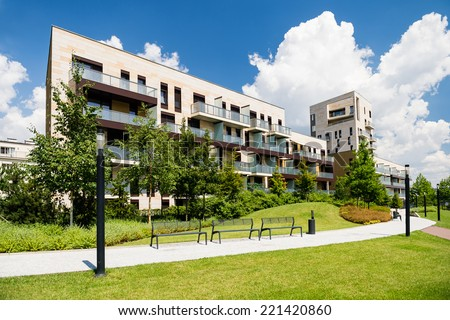 Newly built block of flats with public green area around
