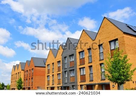 Newly built houses against blue sky - stock photo