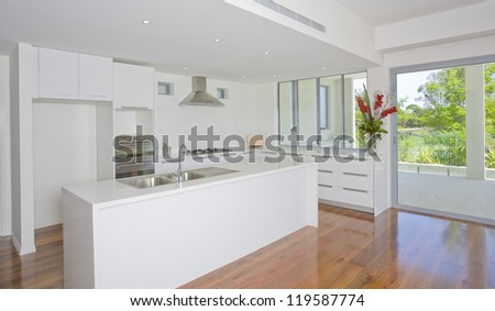 Newly built luxury empty kitchen - stock photo
