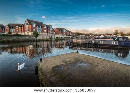 Newly developed marina along the river Weaver in Northwich with new mock Tudor housing.