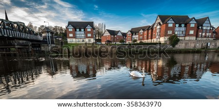 Newly developed mock Tudor housing along the river Weaver in Northwich .