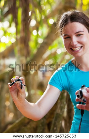 Newly hatched baby turtle in girls hand at Sea Turtles Conservation Research Project in Bentota, Sri Lanka