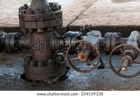 newly installed wellhead in the oil and gas industry - stock photo