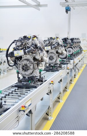 Newly manufactured engine on the production line in a factory. - stock photo