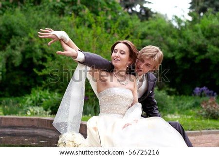 Newly married looking away in the same direction - stock photo