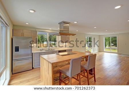 newly remodeled kitchen boasts kitchen island with a hood gray shaker cabinets quartz counters - Newly Remodeled Kitchens