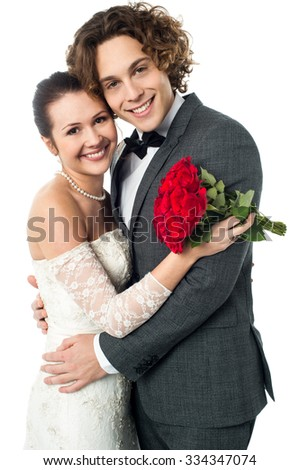 Newly-wed couple embracing each other - stock photo
