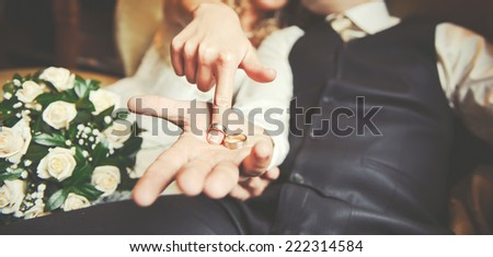 Newly wed couple holding hands.