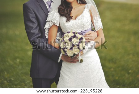Newly wed couple holding hands, autumn wedding.  - stock photo