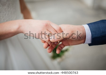 Newly wed couple's hands with wedding rings