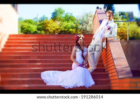 newlyweds against a modern city landscape - stock photo