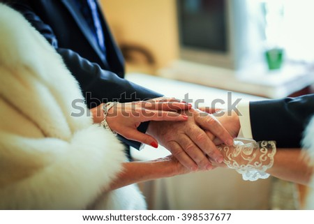 Newlyweds and their parents hands