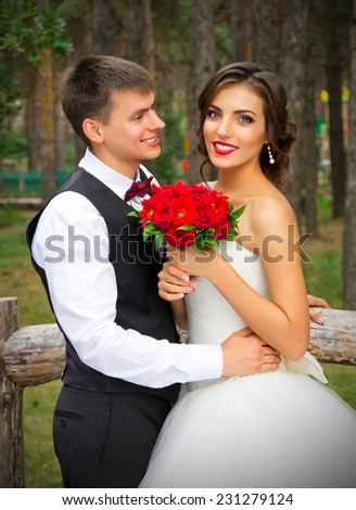 Newlyweds at the summer forest - stock photo