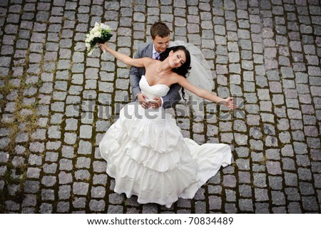 newlyweds dancing on sett - stock photo