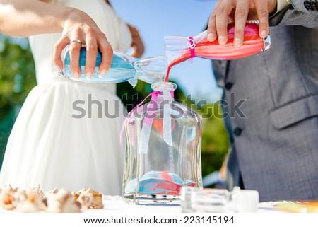 Newlyweds during sand ceremony  - stock photo