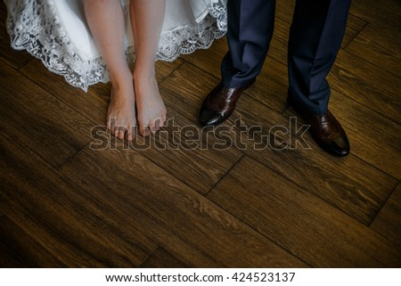 Newlyweds foot on the floor
