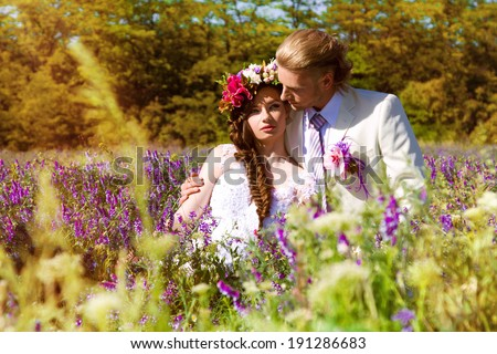 newlyweds in the summer outdoors in a grass