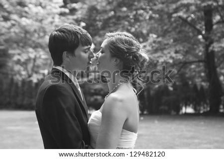 Newlyweds intimate kiss at wedding - stock photo