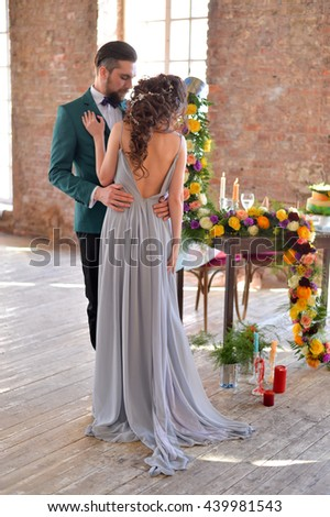 newlyweds near wedding table