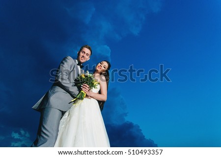 Newlyweds on the background of the sky