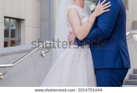 newlyweds on the stairs in the city