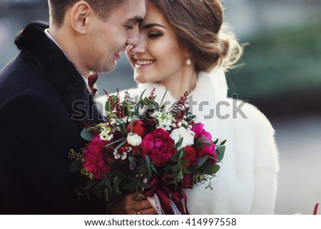 Newlyweds touch each other with noses