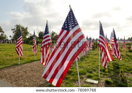 NEWPORT BEACH, CA - MAY 22: Approximately 1776 United States flags were flown in honor of all military, law enforcement, fire and first responders at Castaways Park on May 22, 2011 in Newport Beach, California. - stock photo
