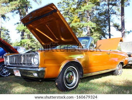 NEWPORT NEWS, VA- OCTOBER 25: A 1966 Dodge Dart Convertible  in the 11th Annual Virginia Fall Classic in Newport News Park in Newport News, Virginia on October 25, 2013