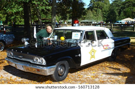 NEWPORT NEWS, VA- OCTOBER 25: A 1963 Ford Mayberry Police car  in the 11th Annual Virginia Fall Classic in Newport News Park in Newport News, Virginia on October 25, 2013 - stock photo