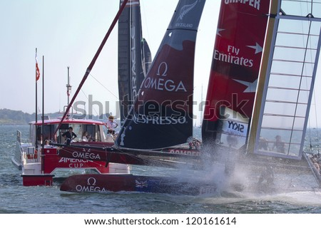NEWPORT, RI - JULY 28:  Team New Zealand rounds mark boat during 2012 America's Cup World Series in Newport, RI on June 28, 2012. - stock photo