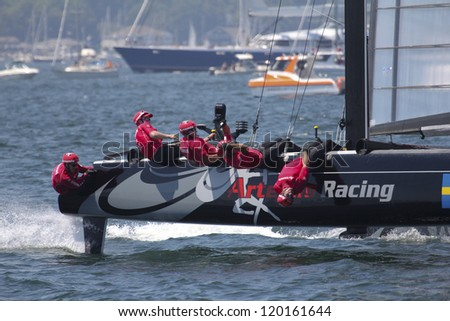 NEWPORT, RI - JULY 30: Terry Huthcinson skippers Artemis Racing during 2012 America's Cup World Series Time Trials in Newport, RI on June 30, 2012. - stock photo