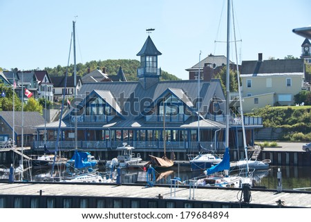 Newport, Vermont, USA  - September 18, 2013: boats line the town pier at Newport Marina on a clear autumn day.