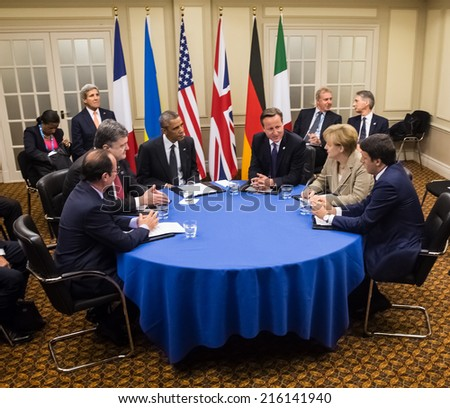 NEWPORT, WALES, UK - Sep 4, 2014:  French President  Hollande, President of Ukraine Poroshenko, US President Obama, British Prime Minister Cameron and German Chancellor Merkel during at NATO summit - stock photo