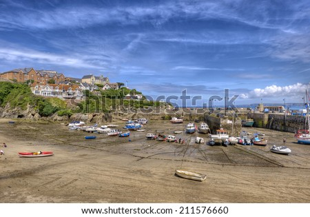 Newquay harbour at low tide, Cornwall, UK. A popular tourist destination in England. - stock photo