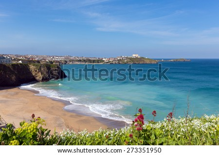 Newquay Tolcarne beach North Cornwall in spring with blue sky and sea and view towards the harbour - stock photo