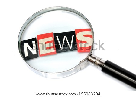 News behind a magnifying glass - stock photo