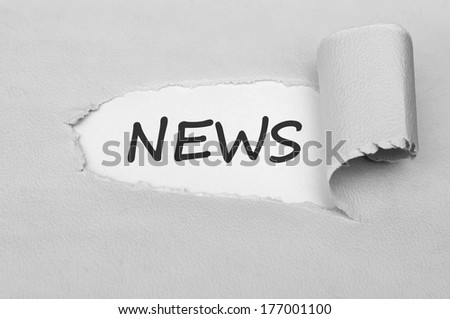 News behind torn paper - stock photo