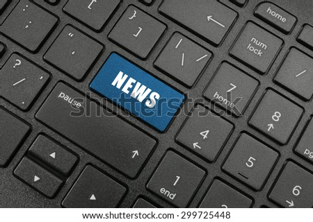 News button on black laptop keyboard
